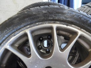 Badly scuffed alloy wheel